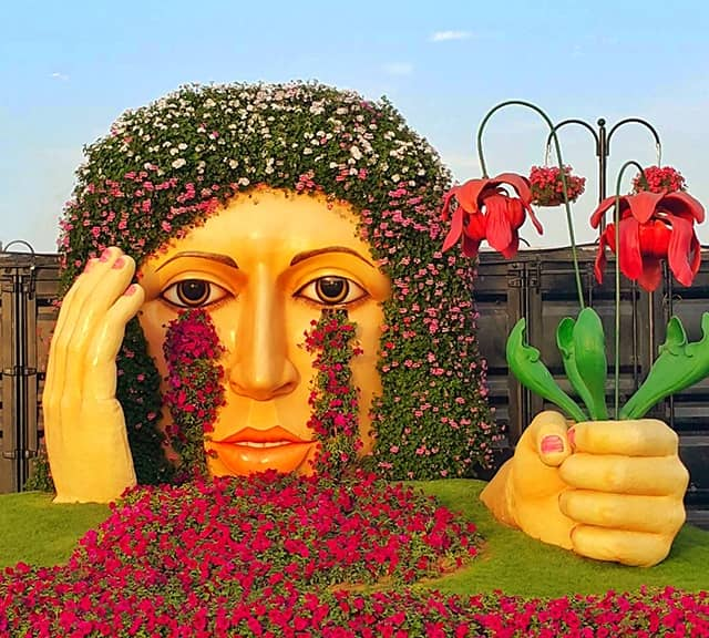 Petunia, Verbena and Marigold flowers are used to decorate the Crying Lady sculpture at the Dubai Miracle Garden