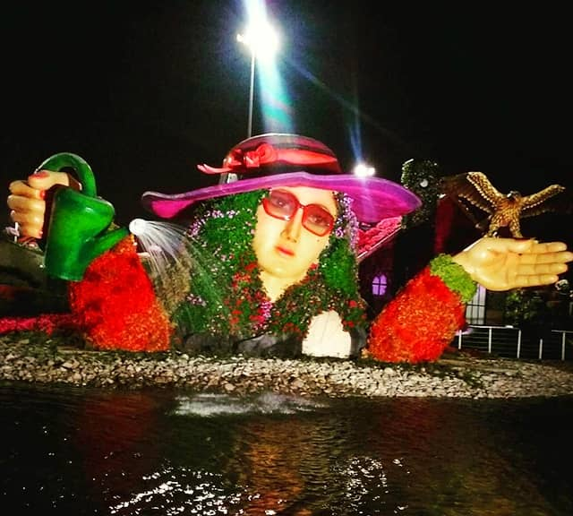 Night photograph of Flower Lady Sculpture at the Dubai Miracle Garden.