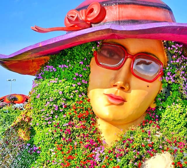 Flower Lady Sculpture is decorated with Petunia flowers.