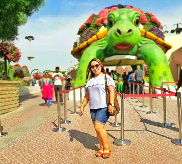 Visitors admire Giant Tortoise at the dubai Miracle Garden