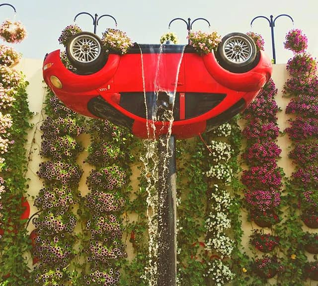 Petunia flowers used to decorate Inverted Volkswagen Car at the Dubai Miracle Garden.
