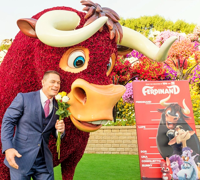 John Cena and Ferdinand smelling flowers at the Dubai Miracle Garden.